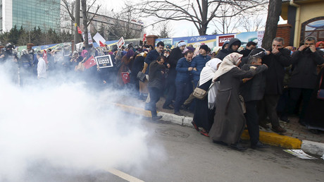 Riot police use tear gas to disperse protesting employees and supporters of Zaman newspaper at the courtyard of the newspaper's office in Istanbul, Turkey March 5, 2016. © Osman Orsal