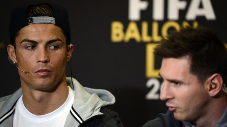 Barcelona's Argentinian forward Lionel Messi (R), Real Madrid's Portugase forward Cristiano Ronaldo (L). © Olivier Morin