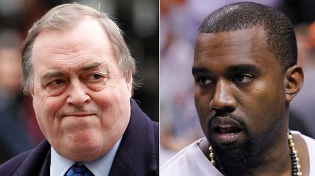 Britain's former Deputy Prime Minister John Prescott (L) and rap musician Kanye West. © Reuters