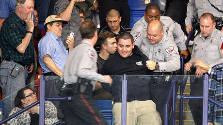 Police officers forcibly remove a protester at U.S. Republican presidential candidate Donald Trump's campaign rally in Fayetteville, North Carolina March 9, 2016 © Jonathan Drake