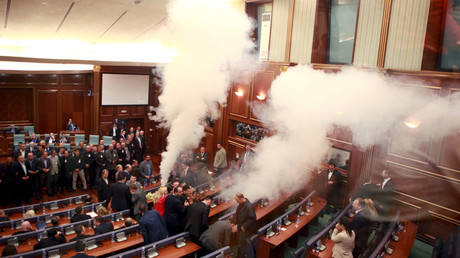 Opposition politicians release tear gas in parliament to obstruct a scheduled session in Pristina October 23, 2015. © Hazir Reka