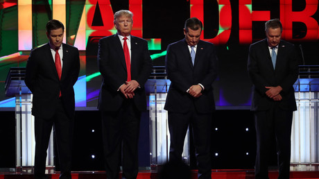 Republican U.S. presidential candidate Donald Trump (2nd from L) looks up as rival candidates Marco Rubio (L), Ted Cruz and John Kasich (R). Republican U.S. presidential candidates debate sponsored by CNN at the University of Miami in Miami, Florida March 10, 2016. © Carlo Allegri
