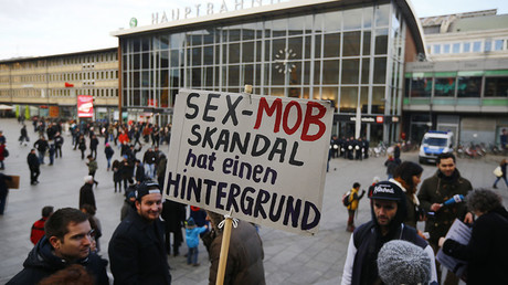 A person holds up a placard reading 'The sex mob scandal has a background' prior to a Patriotic Europeans Against the Islamisation of the West (PEGIDA) demonstration march in front of the main train station in Cologne, Germany, January 9, 2016. © Wolfgang Rattay