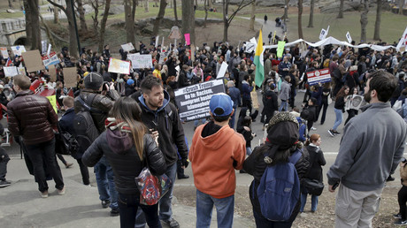 People watch as demonstrators protest against U.S. Republican presidential candidate Donald Trump, in Central Park in New York March 19, 2016. © Brendan McDermid