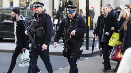 Armed police walk amongst shoppers along Oxford Street in London © Peter Nicholls