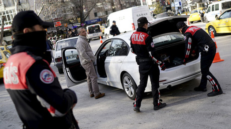 Police officers search a car during a security control check in central Ankara, Turkey © Umit Bektas