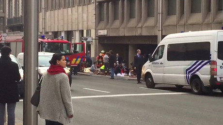 Emergency services personnel tend to people on a pavement outside Maelbeek station in Brussels, Belgium in this still image taken from video on March 22, 2016 © Stijn Hoorens