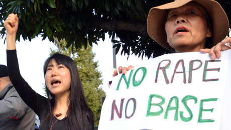 File photo: Civic group members shout slogans and hold placards as they attend a protest over the alleged rape of a local woman by two US servicemen in Okinawa, in front of the prime minister's official residence in Tokyo. © Yoshikazu Tsuno