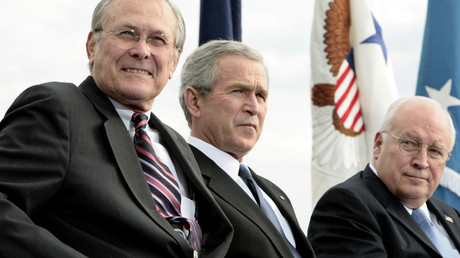 Donald Rumsfeld (L), George W. Bush (C) and Dick Cheney © Larry Downing