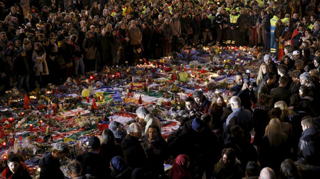People gather at the Place de la Bourse to pay tribute to the victims of Tuesday's bomb attacks in Brussels, Belgium, March 25, 2016. © Christian Hartmann