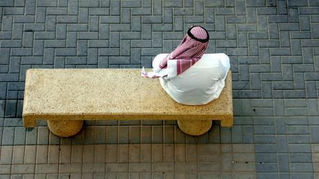 An Arab Gulf man rests on a main street in Riyadh © Ali Jarekji