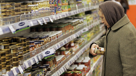 A woman reads the label of a food product at a supermarket in Kiev © Konstantin Chernichkin