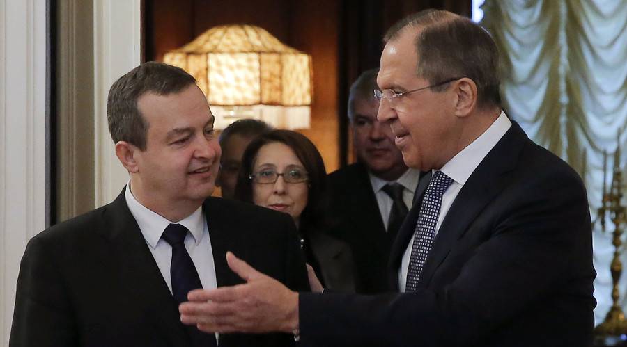 Russian Foreign Minister Sergei Lavrov (R) shows the way to his Serbian counterpart Ivica Dacic during a meeting in Moscow, Russia, April 1, 2016. © Maxim Shemetov
