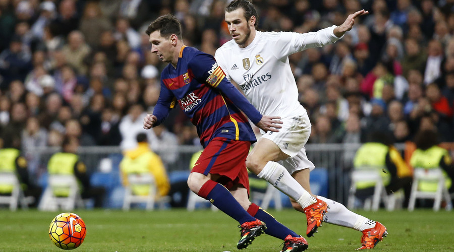 Real Madrid's Gareth Bale in action with Barcelona's Lionel Messi. © Paul Hanna