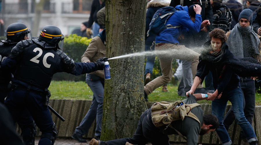 French gendarmes use tear gas during clashes with youths during a demonstration by employees, high school and university students against the French labour law proposal in Lille, France, as part of nationwide labor reform protests and strikes, March 31, 2016. © Pascal Rossignol