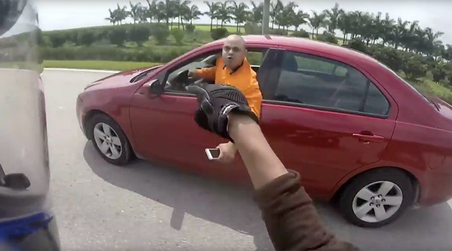 Crazy high speed 'car v motorbike' dual ignited by Florida road rage (VIDEO)