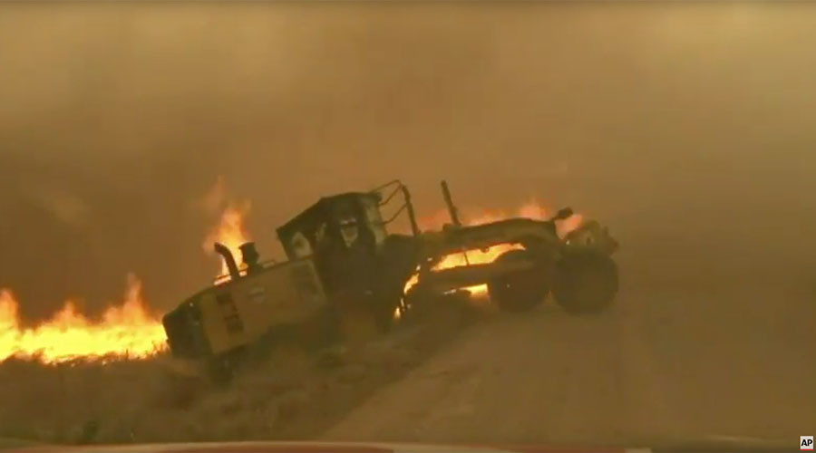 News team saves man from raging inferno while chasing Oklahoma wildfires (VIDEO)
