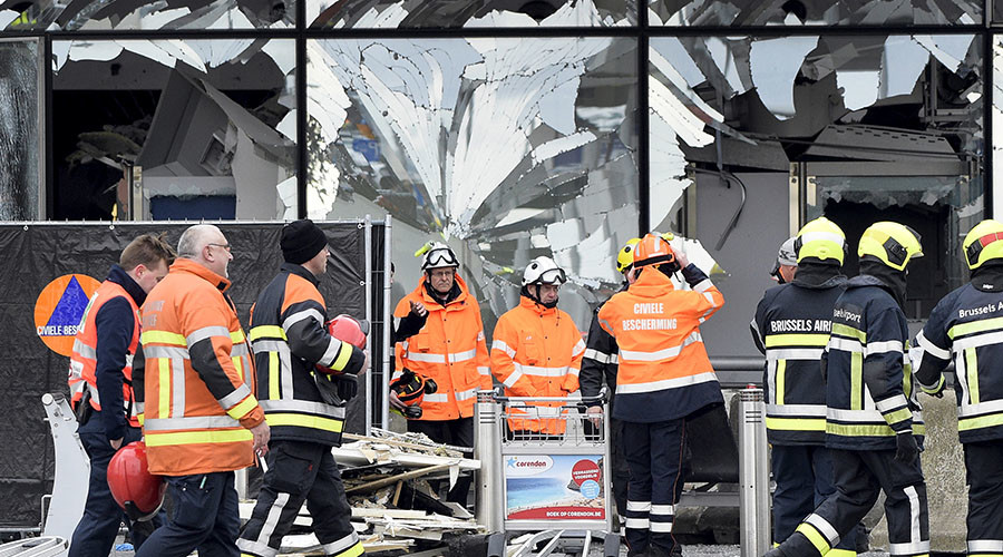 Broken windows of the terminal at Brussels airport are seen during a ceremony following bomb attacks in Brussels in Zaventem, Belgium, March 23, 2016. ©Yorick Jansens