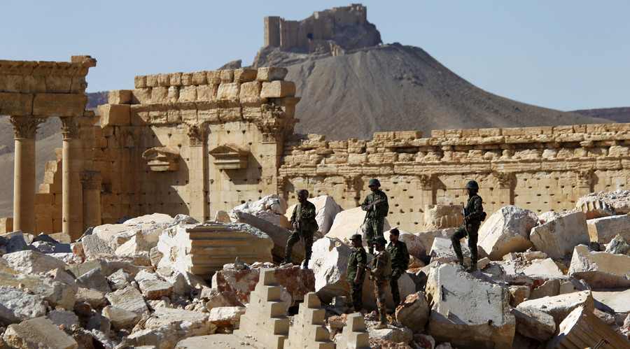 Syrian army soldiers stands on the ruins of the Temple of Bel in the historic city of Palmyra, in Homs Governorate, Syria April 1, 2016. © Omar Sanadiki