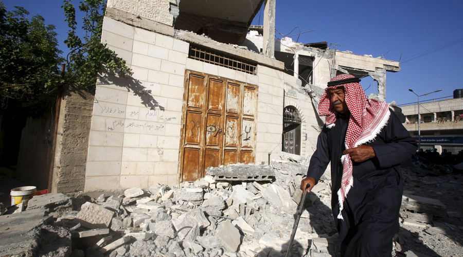 A man walks past the damaged house of Palestinian assailant Ahmad Zakarneh after it was partially demolished by Israeli forces in the West Bank town of Qabatya near Jenin April 4, 2016. © Abed Omar Qusini