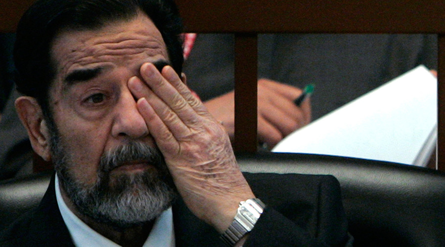 FILE PHOTO: Ousted Iraqi President Saddam Hussein covers one of his eyes while listening to the prosecution during the Anfal genocide trial in Baghdad December 21, 2006 © Nikola Solic