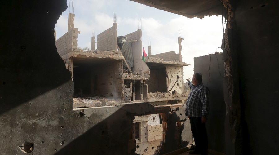 A man stands in his house which was destroyed during clashes between military forces loyal to Libya's eastern government and the Shura Council of Libyan Revolutionaries, an alliance of former anti-Gaddafi rebels, in Benghazi, Libya, in March 2016. © Esam Omran Al-Fetori