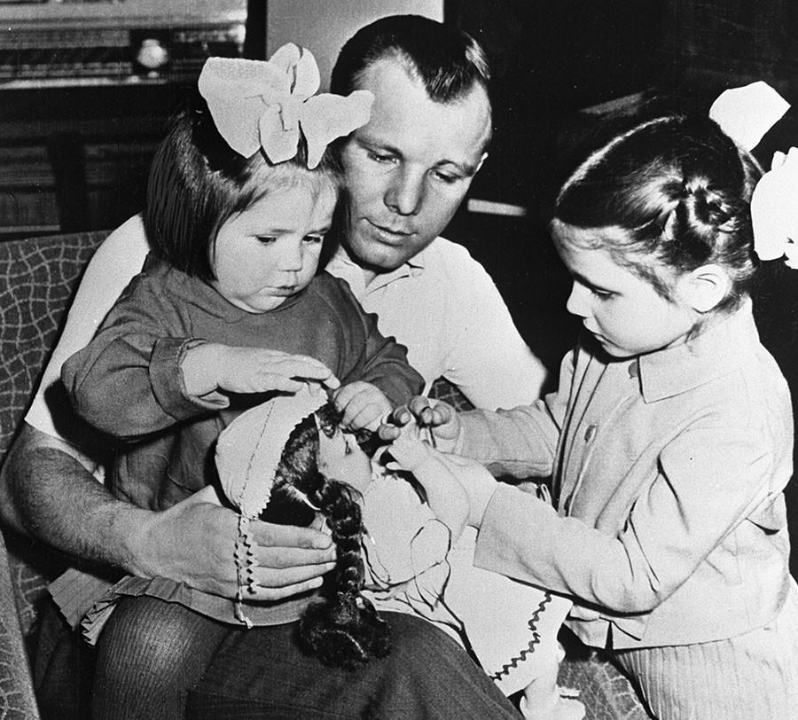 Pilot-Cosmonaut Yuri Gagarin (center) with daughters Lena (right) and Galya (left). ©Alexander Mokletsov