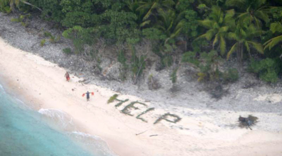 Castaways rescued from remote island after spelling 'help' on beach (PHOTOS)