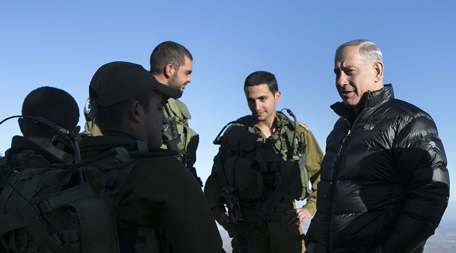 FILE PHOTO. Israel's Prime Minister Benjamin Netanyahu (R) talks with Israeli soldiers at a military outpost on February 4, 2015 during a visit at Mount Hermon which sits in the Israeli occupied Golan Heights on the border between Lebanon, Syria and Israel. © Baz Ratner