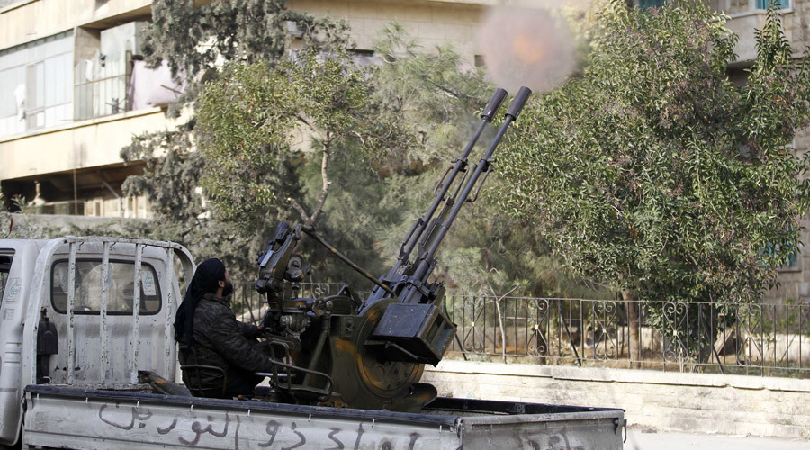 A member of Islamist militant group Jabhat al-Nusra fires a weapon on the back of a lorry in Aleppo's Bustan al-Qasr neighbourhood © Molhem Barakat