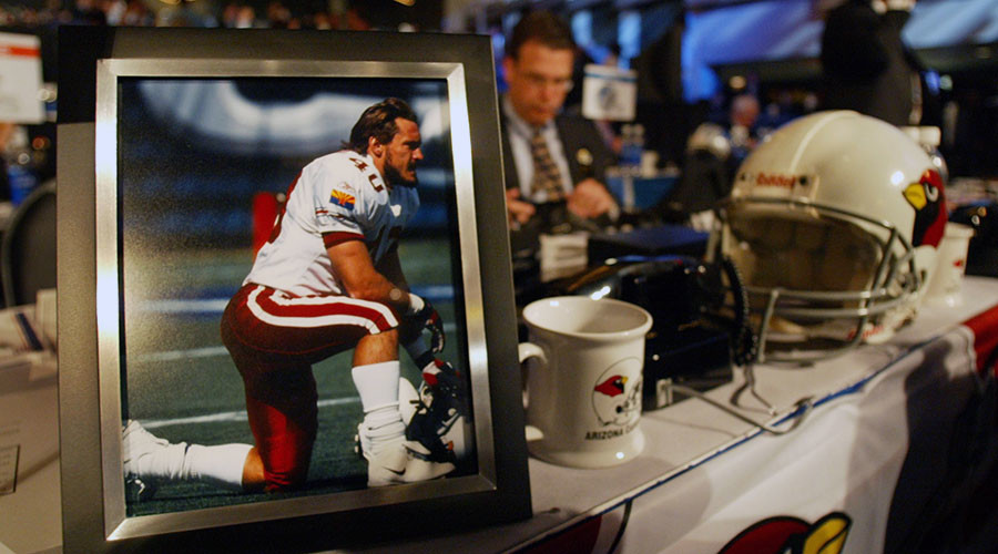 A photograph of former Arizona Cardinals player Pat Tillman sits on the team's 2004 NFL Draft desk at Madison Square Garden. © Mike Segar