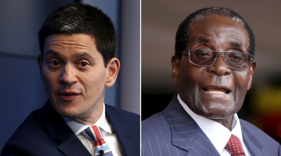 Former Labour Foreign Secretary David Miliband (L) and Zimbabwe's President Robert Mugabe. © Reuters