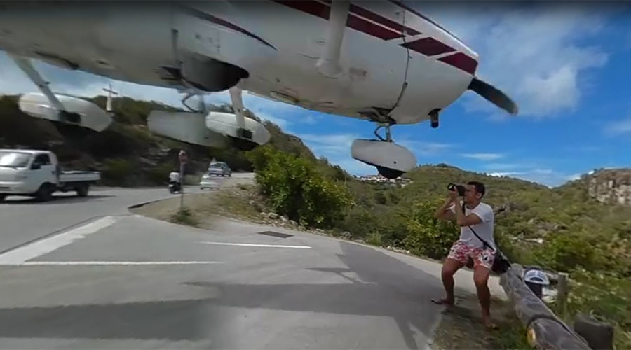 'It hit my hand!': Tourist's jaw-dropping near miss with airplane (VIDEO)