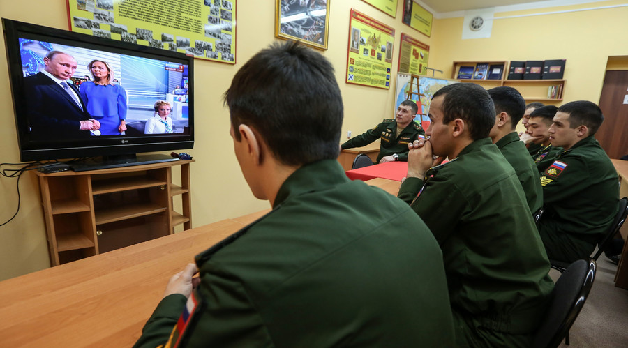 Cadets at the Rokosskovsky Far Eastern Higher Command School in Blagoveshchensk watch the live broadcast of the annual Direct Line with Vladimir Putin. © Igor Ageyenko