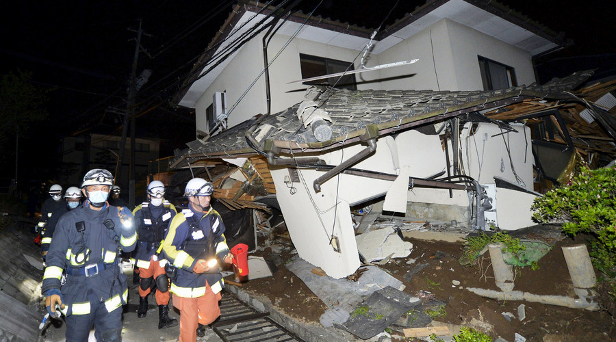 Firefighters check a collapsed house after an earthquake in Mashiki town, Kumamoto prefecture, southern Japan, in this photo taken by Kyodo April 15, 2016. © Kyodo