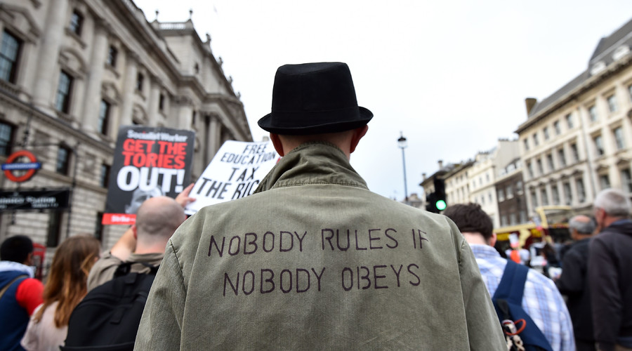 Protestors march during an anti-austerity demonstration in London. © Ben Stansall