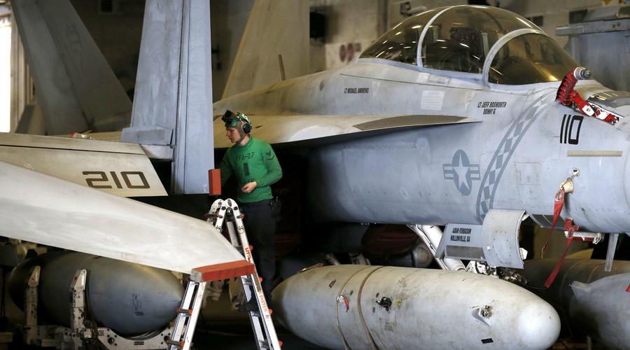 A US Navy crew member maintains an F/A-18 Super Hornet fighter. © Kim Hong-Ji
