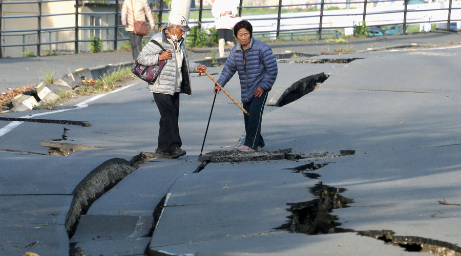 Local residents look at cracks caused by an earthquake on a road in Mashiki town, Kumamoto prefecture, southern Japan, in this photo taken by Kyodo April 16, 2016. © Reuters