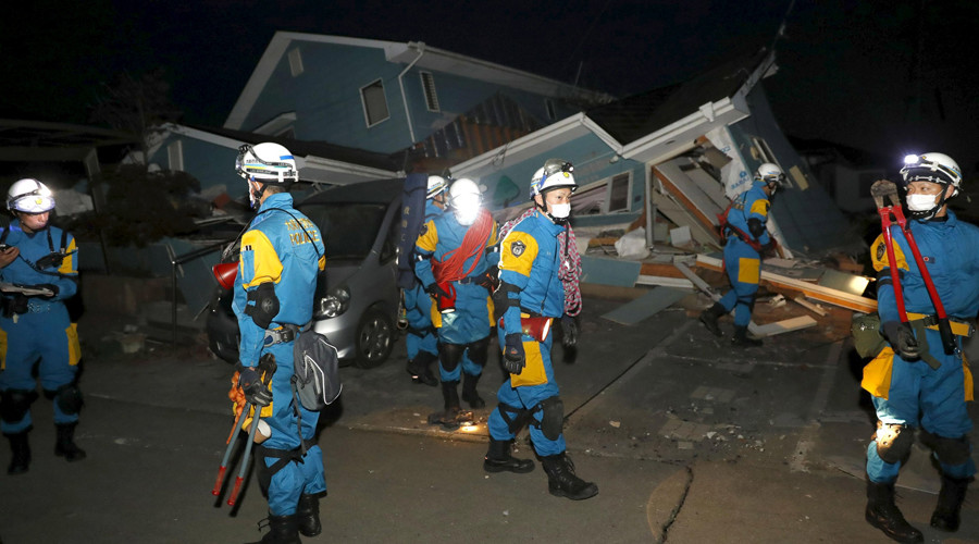 Police officers check a collapsed house after an earthquake in Mashiki town, Kumamoto prefecture, southern Japan, in this photo taken by Kyodo April 16, 2016. © Reuters