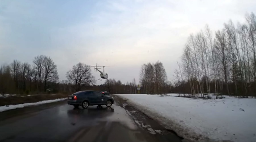 From on high: Priest's chopper lands on highway in Russia (VIDEO)