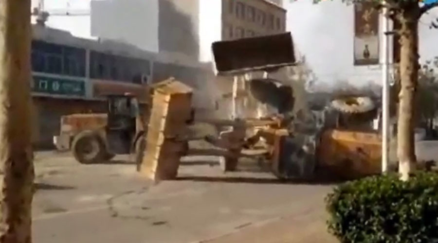 Bulldozers in China fight.