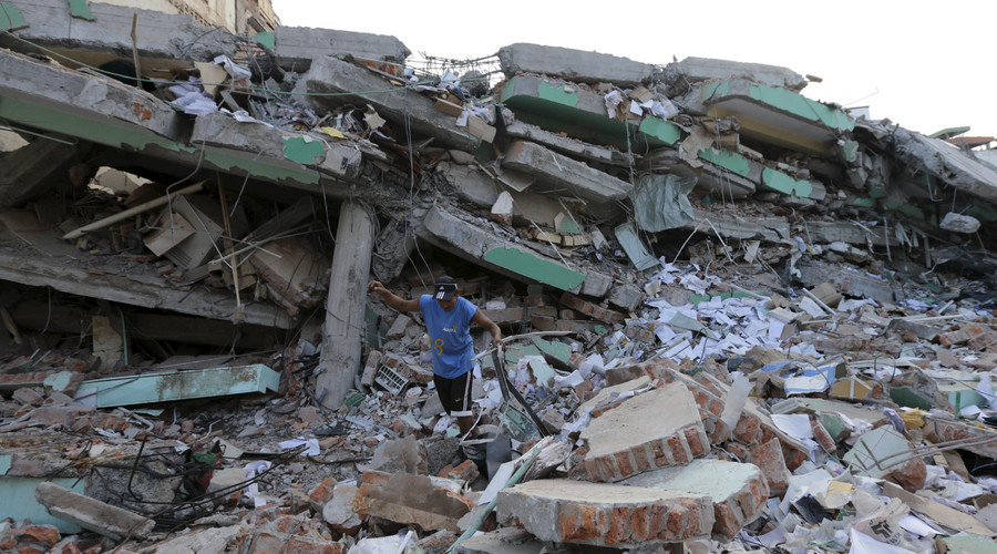 A worker clears debris of a collapsed building after an earthquake struck off the Pacific coast, in Portoviejo, Ecuador, April 18, 2016. © Henry Romero