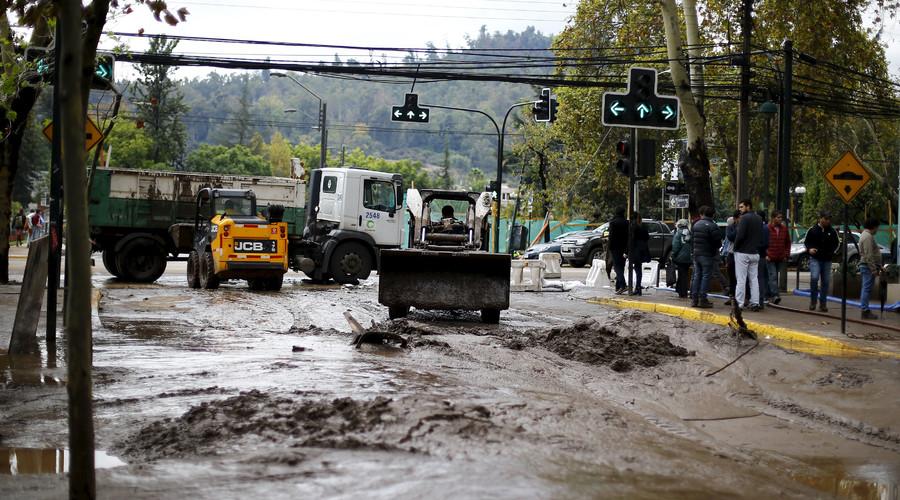 A loader removes mud in a street after a flood in Santiago, April 18, 2016. © Ivan Alvarado