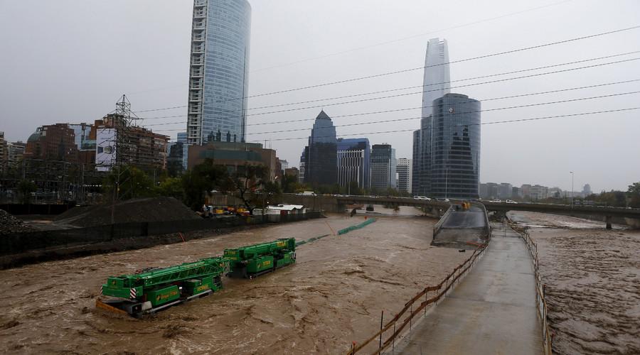 Crane are seen on a flooded street in Santiago, April 17, 2016. © Ivan Alvarado