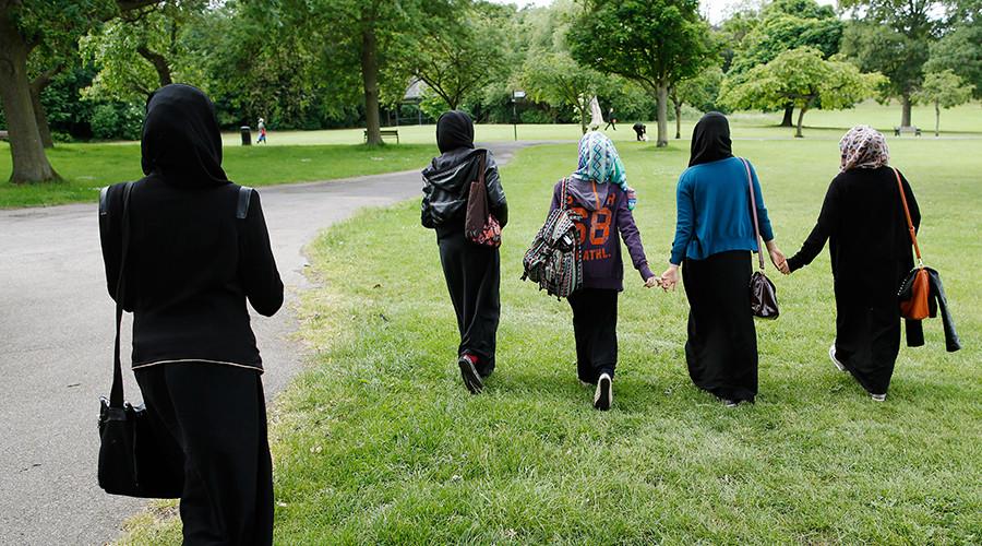Students walk in the park near their school in Hackney, east London © Olivia Harris