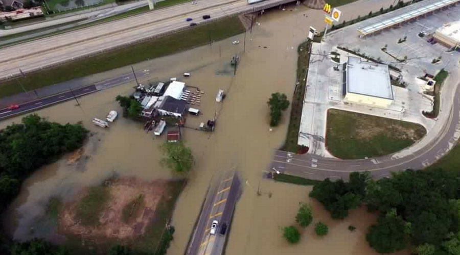 Houston flooding kills 8, causes billions worth of damage (PHOTOS, VIDEOS)