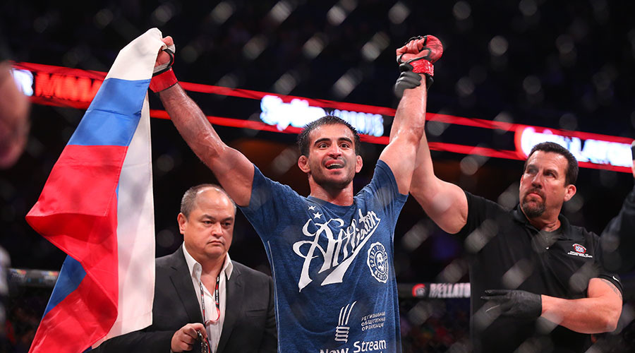 Bellator welterweight champion Andrey Koreshkov celebrates his decision win over challenger Benson Henderson (not shown) to retain his title. © Ed Mulholland / Getty Images / AFP