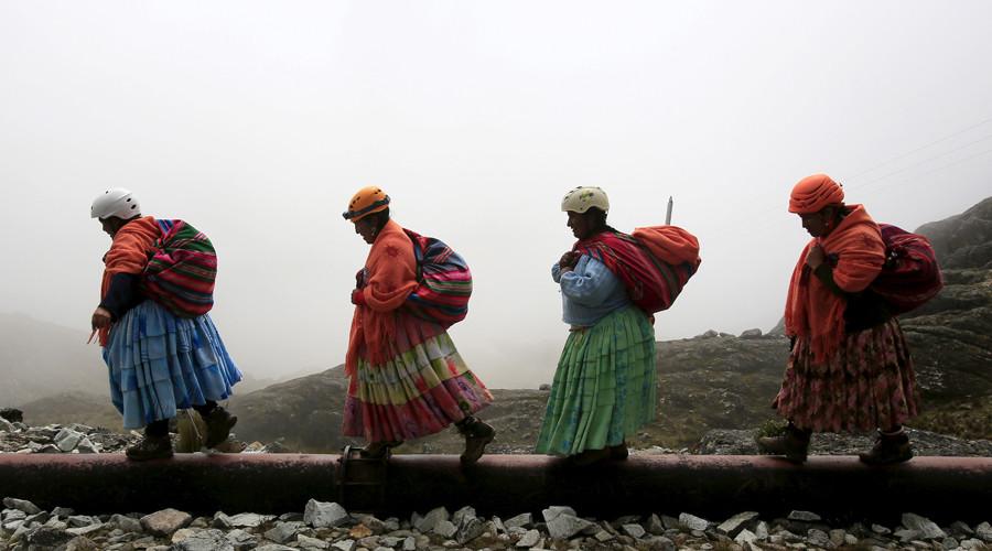 Aymara indigenous women walk toward Huayna Potosi mountain, Bolivia April 6, 2016. © David Mercado
