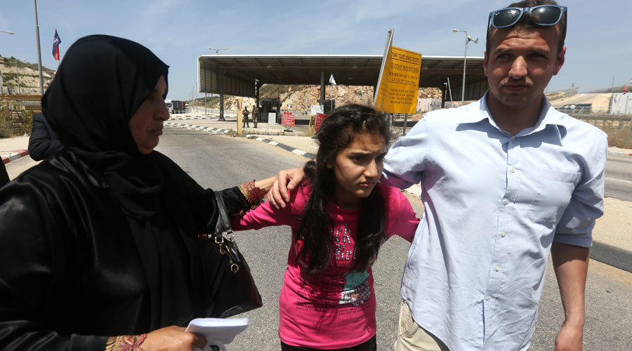 The mother (L) and brother of Palestinian Dima al-Wawi, 12, who is believed to be the youngest female detained by Israel, greet her in the West Bank city of Tulkarem, upon her release from Israeli prison on April 24, 2016. © Jaafar Ashtiyeh