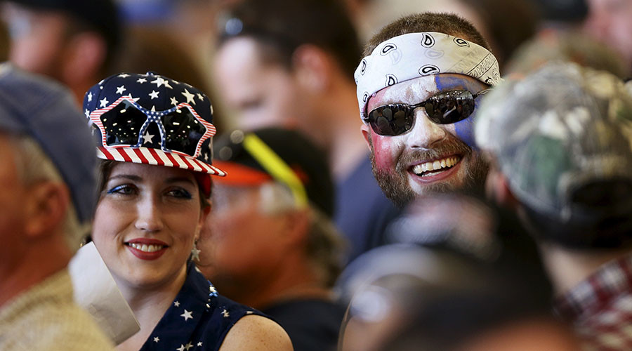 Two supporters of Republican U.S. presidential candidate Donald Trump attend a Trump campaign rally two days before the Maryland presidential primary election at the airport in Hagerstown, Maryland, U.S. © Jim Bourg